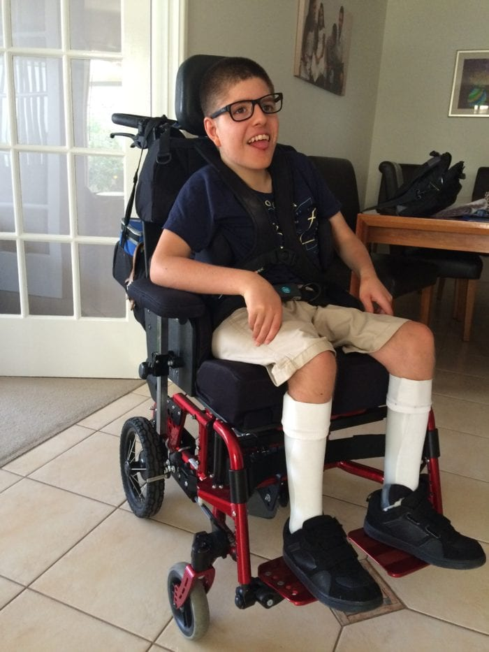 Harrison sits in his completed wheelchair.